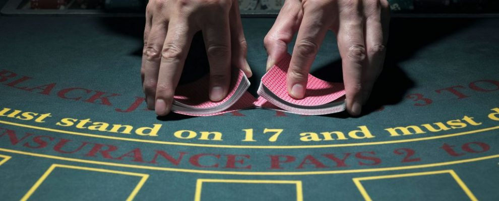 217759-1600x1065-casino-dealer-with-cards